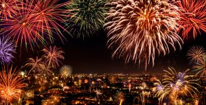 Whole city celebrating the New Year or any national event with delightful fireworks, copyspace on the night sky